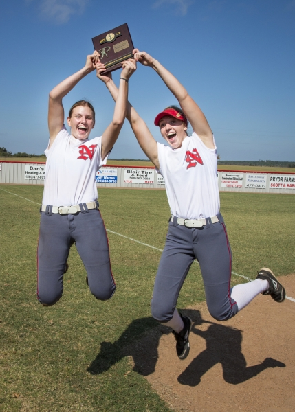 1525884406-two-girls-holding-a-softball-plaque