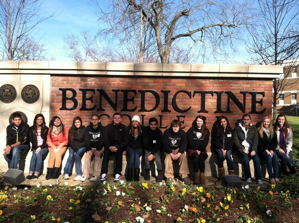 Students standing in front of Benedictine sign