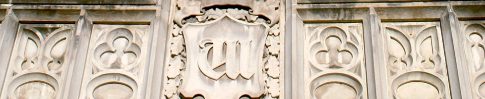 close-up of stone carving of a w on a building