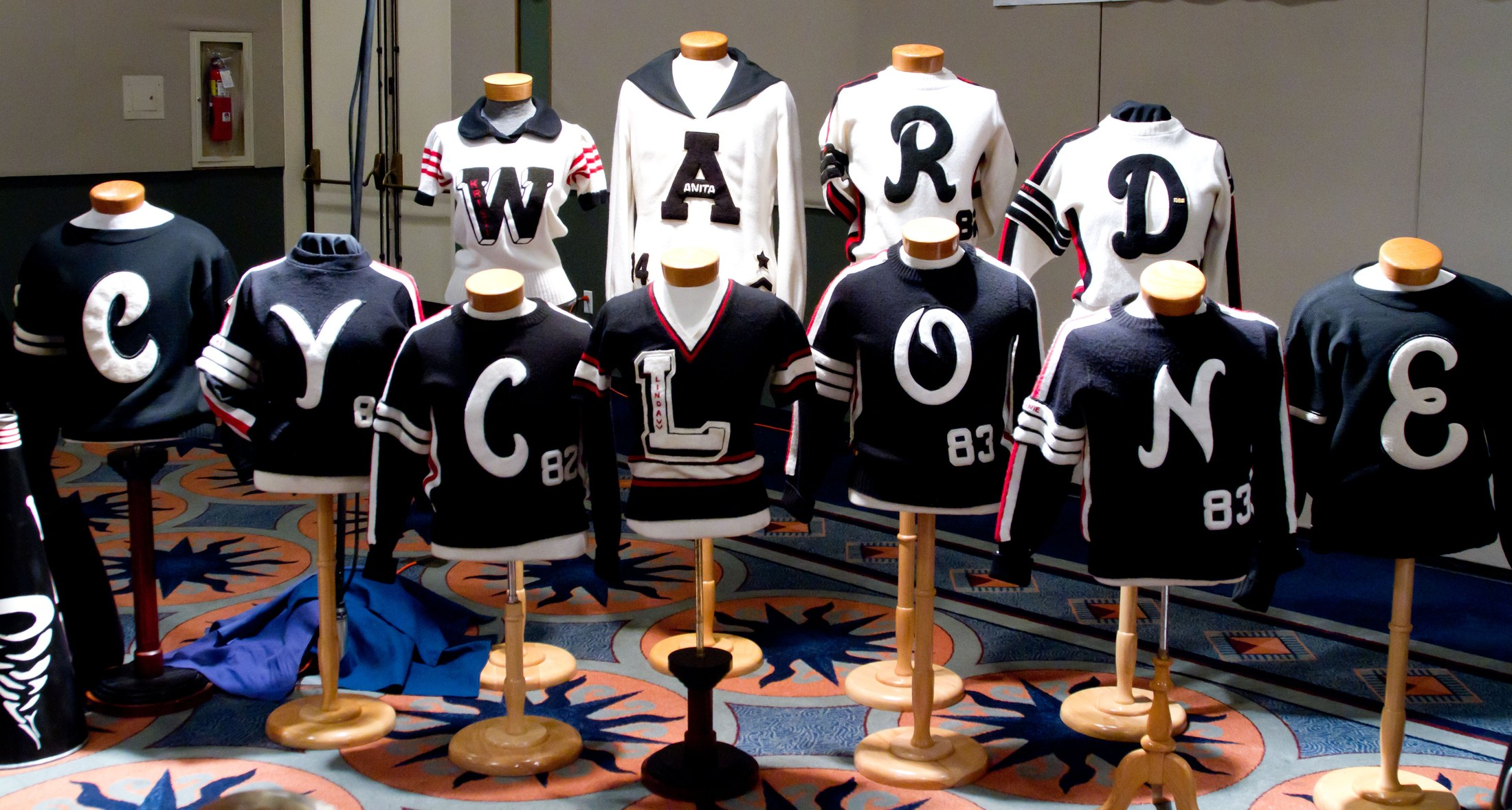Mannequin shirts arranged to spell out Ward Cyclone