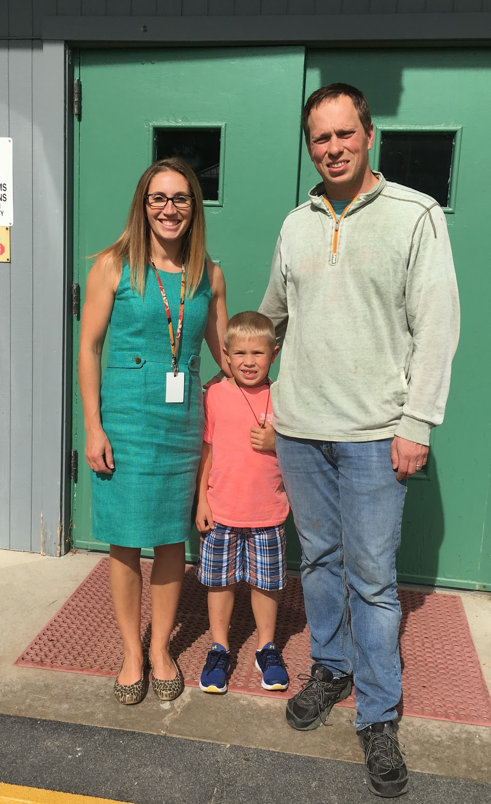 Bartash Family Photo in front of school doors