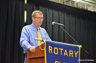 Larry Whitmer speaking at a podium