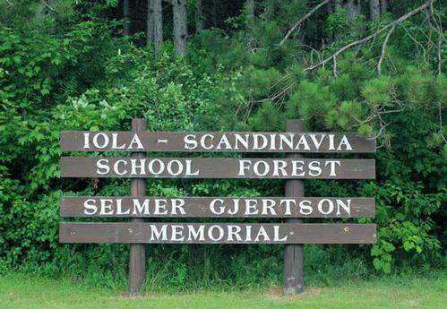Iola-Scandinavia School Forest Selmer Gjertson Memorial sign in front of the forest