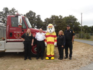 10th Seneca Fire Department and Sparky the Fire Dog lead a fire prevention and safety drill