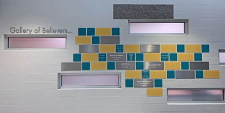 Wall of tiles representing donors