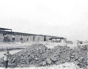 Black and white photo of early construction of school