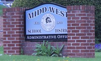 The Midd West School District sign