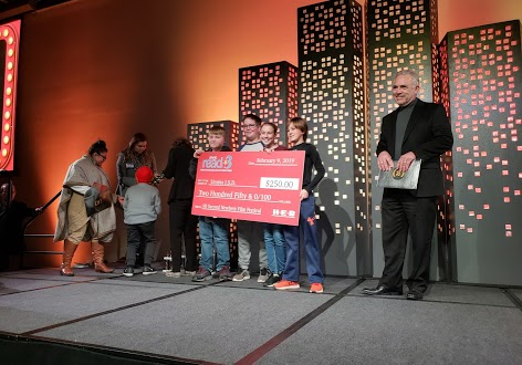 Students receiving their check