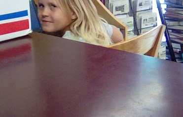 Girl sitting at library table
