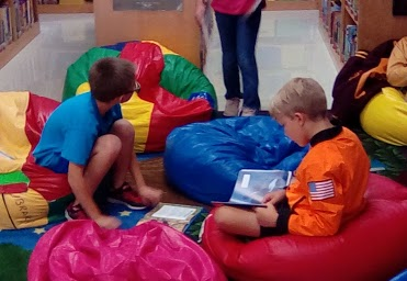 Kids reading on bean bags