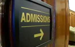 Admissions sign with an arrow.