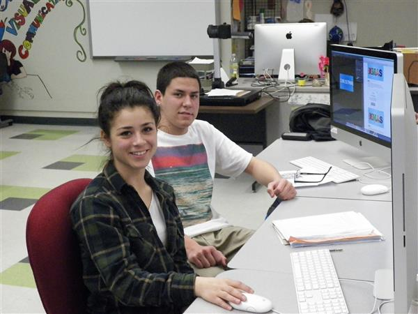 Students at their computer desk