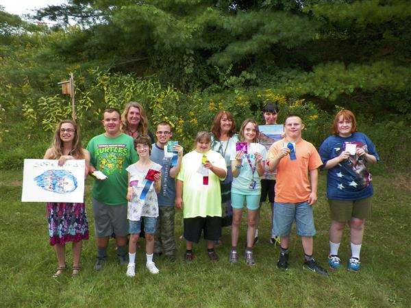 Special education students pose with ribbons from local fair