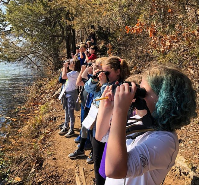 FPs Students experiencing Lake Fayetteville with binoculars.