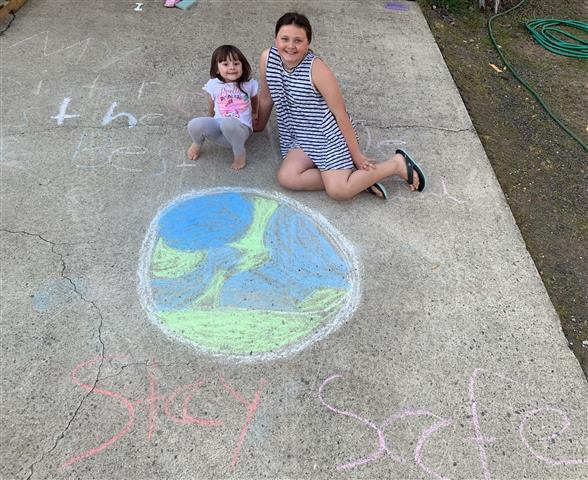 Students are encouraged to use sidewalk chalk to create art and games during The Great Woodland Chalk Out