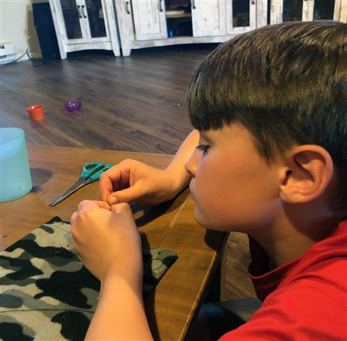 Logan Gnade, a 4th grader at North Fork Elementary School, used math and sewing to design patterns and sew face masks for friends and family