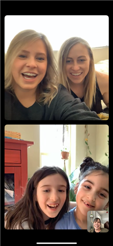 Liz Vallaire's kindergartner, Harper, and second grader, Zoey, use video conferencing to receive assignments and stay connected with their teachers