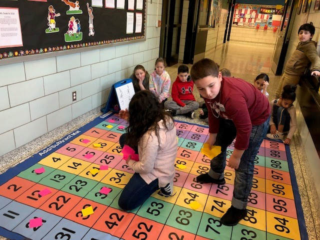 Mrs. Kresic's fourth-grade class finding factors of numbers and least common multiples on our new mats!