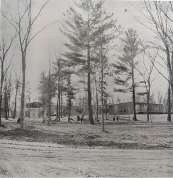 This picture comes from the 1960 yearbook and is at the cornor of 4th steet and Beech. You can see the new construction behind the trees on the left.