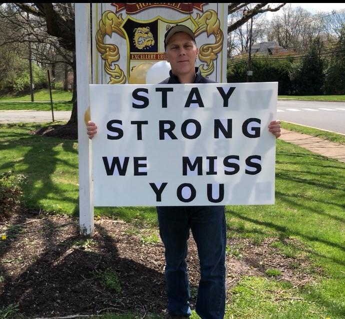Superintendent Smith holds Stay Strong sign