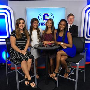 a photo of the news team